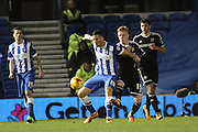 Brighton striker, Tomer Hemed (10) shields the ball from Brentford midfielder Ryan Woods during the Sky Bet Championship match between Brighton and Hove Albion and Brentford at the American Express Community Stadium, Brighton and Hove, England on 5 February 2016. Photo by Geoff Penn.