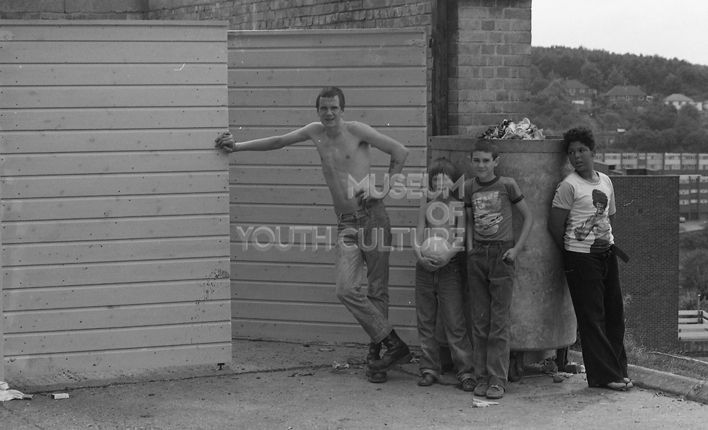 Boys Standing by a Rubbish Bin, High Wycombe, UK, 1980s.