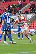 Andrew Butler (6) of Doncaster Rovers  celebrates scoring to go 1 all during the Sky Bet League 1 match between Doncaster Rovers and Wigan Athletic at the Keepmoat Stadium, Doncaster, England on 16 April 2016. Photo by Ian Lyall.