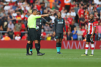 Football - 2019 / 2020 Premier League - Southampton vs. Liverpool<br /> <br /> Referee Mr Andre Marriner explains the non contested drop ball law during the Premier League match at St Mary's Stadium Southampton <br /> <br /> COLORSPORT/SHAUN BOGGUST