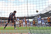 Michael Dawson heads the ball into the goal to make it 1 all during the Sky Bet Championship match between Hull City and Queens Park Rangers at the KC Stadium, Kingston upon Hull, England on 19 September 2015. Photo by Ian Lyall.