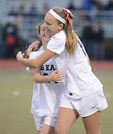 Central Bucks East's Delaney Kennedy (left) and Jillian Pawelski celebrate after CB East defeated Downingtown West to win the District One AAA Cgirls soccer championship Saturday November 7, 2015 in Souderton, Pennsylvania.  (Photo by William Thomas Cain)