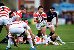 Fumiaki Tanaka of Japan passes the ball - Mandatory byline: Patrick Khachfe/JMP - 07966 386802 - 23/09/2015 - RUGBY UNION - Kingsholm Stadium - Gloucester, England - Scotland v Japan - Rugby World Cup 2015 Pool B.