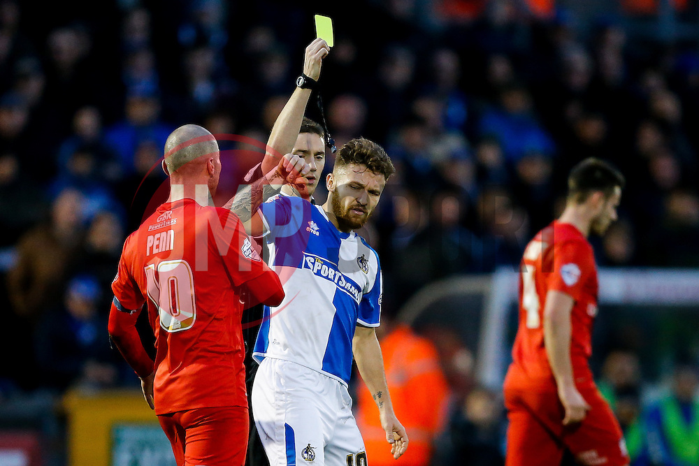 Matt Taylor of Bristol Rovers is pushed by Russell Penn of York City as he is shown a yellow card by referee Ben Toner - Mandatory byline: Rogan Thomson/JMP - 07966 386802 - 12/12/2015 - FOOTBALL - Memorial Stadium - Bristol, England - Bristol Rovers v York City - Sky Bet League 2.