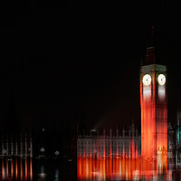The Palace of Westminster with the Big Ben at night.