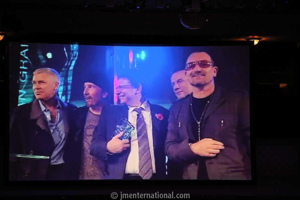 Lucian Grainge and U2, the 2011 MITs Award. Held at the Grosvenor Hotel London in aid of Nordoff Robbins and the BRIT School. Monday, Nov.7, 2011