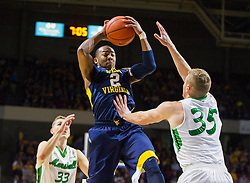 Dec 17, 2015; Charleston, WV, USA; West Virginia Mountaineers guard Jevon Carter (2) grabs a rebound over Marshall Thundering Herd guard Austin Loop (35) during the first half at the Charleston Civic Center . Mandatory Credit: Ben Queen-USA TODAY Sports