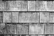 Wood siding bears dozens of marks from passersby. Most commonly one can find professions of love adorned with carvings of a heart.