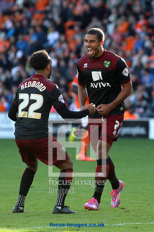 Lewis Grabban of Norwich celebrates scoring his side's 2nd goal with Nathan Redmond of Norwich during the Sky Bet Championship match at Bloomfield Road, Blackpool<br /> Picture by Paul Chesterton/Focus Images Ltd +44 7904 640267<br /> 27/09/2014