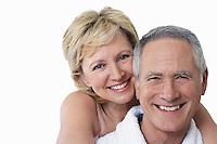 Portrait of loving couple smiling over white background