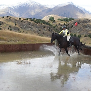 Jo Counsell riding Rainbow Tomtom in action at the water jump during the Cross Country event at the Wakatipu One Day Horse Trials at the Pony Club grounds,  Queenstown, Otago, New Zealand. 15th January 2012. Photo Tim Clayton