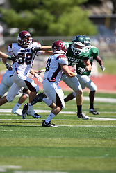 08 September 2012:  Aaron Hahn scrambles towards the right during an NCAA division 3 football game between the Alma Scots and the Illinois Wesleyan Titans which the Titans won 53 - 7 in Tucci Stadium on Wilder Field, Bloomington IL