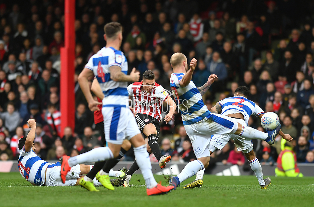 Brentford forward Sergi Canos (7) scores their third goal to make it 3-0*** during the EFL Sky Bet Championship match between Brentford and Queens Park Rangers at Griffin Park, London, England on 2 March 2019.