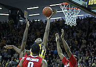 January 07, 2011: Iowa Hawkeyes forward Melsahn Basabe (1) blocks a shot as Ohio State Buckeyes forward Jared Sullinger (0) and Ohio State Buckeyes forward J.D. Weatherspoon (15) look on during the the NCAA basketball game between the Ohio State Buckeyes and the Iowa Hawkeyes at Carver-Hawkeye Arena in Iowa City, Iowa on Saturday, January 7, 2012.