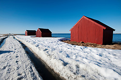 Red hut by sea in village of Eggum on Lofoten Islands in Norway