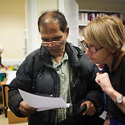 Francis Palma. Dr Susan Collinson, Tb case worker at the Homerton Tb unit, helps Francis understand his next appointment.TB nurse Meryl Pont gets Francis' medicine ready in the back ground.
