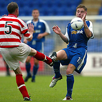 St Johnstone v Hamilton Accies 06.08.02<br />Ryan Stevenson takes one in the face from Sean Sweeney<br /><br />Pic by Graeme Hart<br />Copyright Perthshire Picture Agency<br />Tel: 01738 623350 / 07990 594431