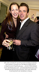MR JOEL CADBURY and the HON.CAMILLA ASTOR, at a party in London on 7th March 2002.	OYD 5