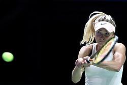 October 21, 2018 - Singapore, Singapore - Elina Svitolina of the Ukraine returns a shot during the match between Petra Kvitova and Elina Svitolina on day 1 of the WTA Finals at the Singapore Indoor Stadium. (Credit Image: © Paul Miller/ZUMA Wire)