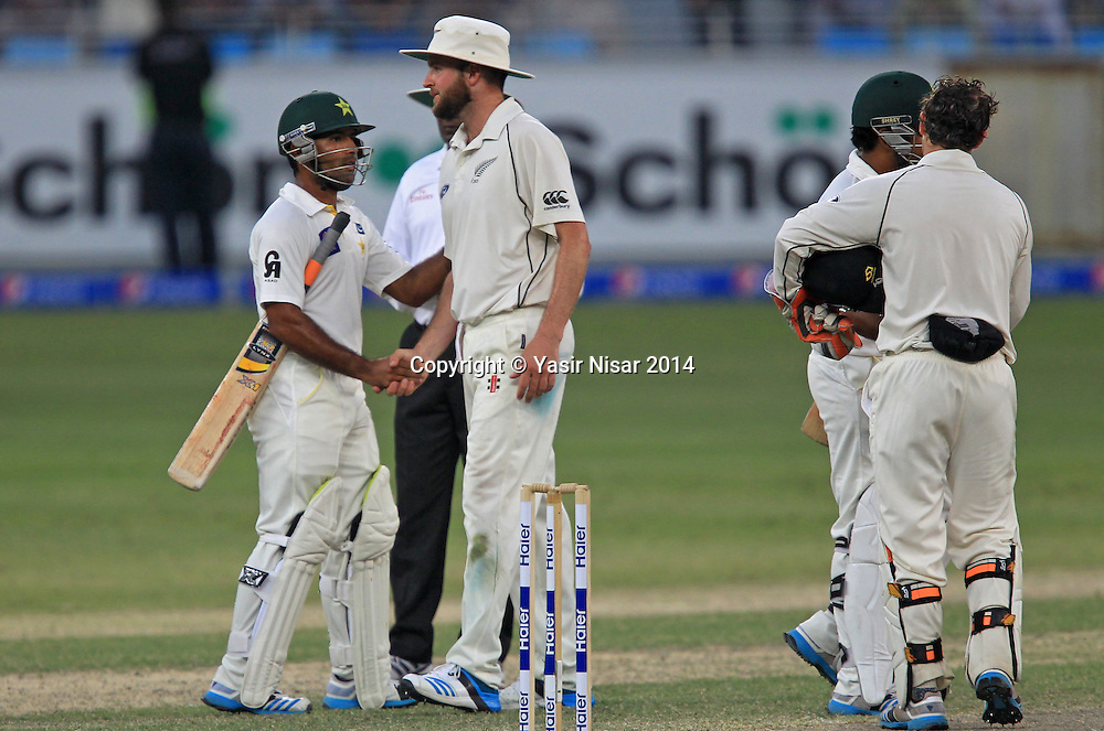 Pakistan vs New Zealand, 21 November 2014 <br /> Pakistani players greet NZ players after the match was draw on the fifth day of second test in Dubai