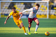 Aaron Hickey (#51) of Heart of Midlothian FC bursts past Keaghan Jacobs (#7) of Livingston FC during the Ladbrokes Scottish Premiership match between Livingston FC and Heart of Midlothian at the Tony Macaroni Arena, Livingston, Scotland on 26 October 2019.