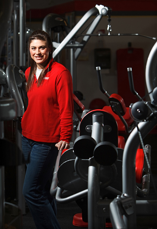 Owner, and an American Council on Exercise (ACE) certified personal trainer, Ashley Schneider poses for a portrait at Snap Fitness in Grand Island. Before purchasing the franchise earlier this week, Schneider worked as a personal trainer at the facility for a  year. She grew up in Dannebrog and earned a bachelor of science in exercise science from the University of Nebraska at Kearney, where she also played basketball. (Independent/Matt Dixon)