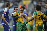 Leicester - Saturday, February 16th, 2008: Norwich City's Ched Evans (R) is held back by Matt Oakley (C) during the Coca Cola Champrionship match at the Walkers Stadium, Leicester. (Pic by Mark Chapman/Focus Images)
