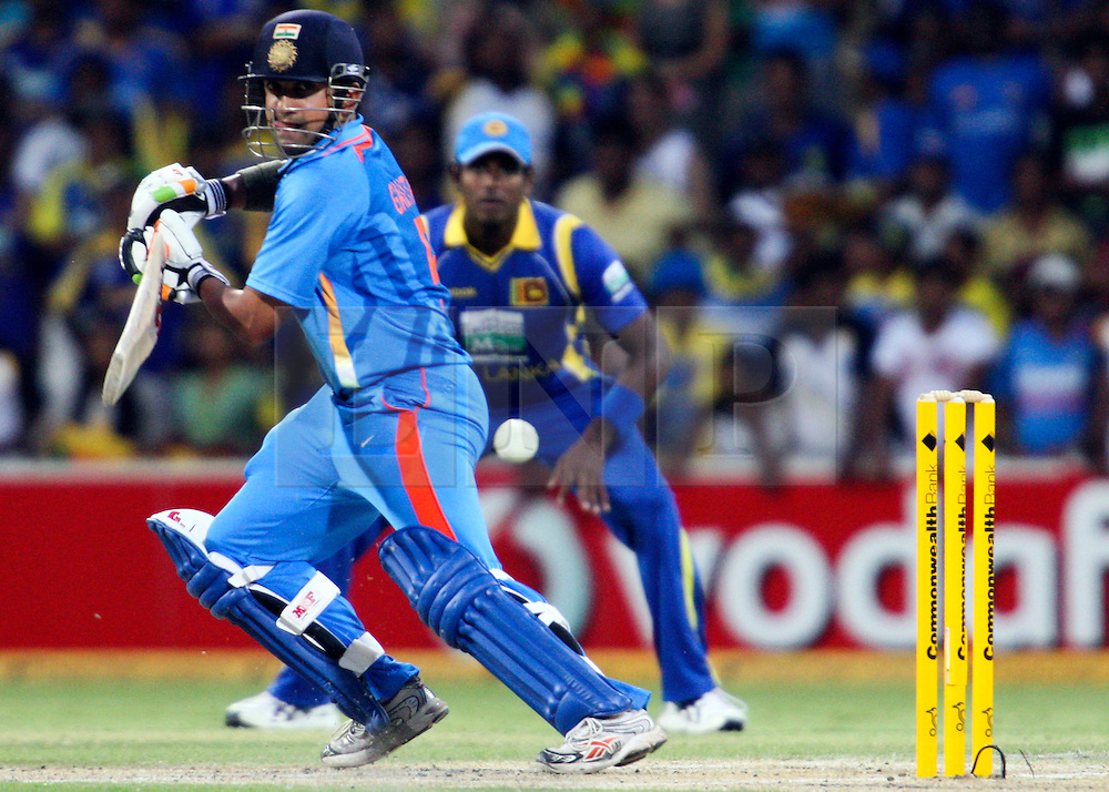 © Licensed to London News Pictures. 14/02/2012. Adelaide Oval, Australia. Gautam Gambhir plays a cut shot during the One Day International cricket match between India Vs Sri Lanka. Photo credit : Asanka Brendon Ratnayake/LNP