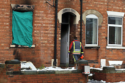 (c) London News Pictures. 04-12-2010. A Fireman enters the scene of a house fire in Newark-On-Trent today (Saturday).The scene of a house fire in Newark-On-Trent today (Saturday). Officers were called to the house at approximately 3:30pm yesterday evening, and the body of a lady who is yet to be identified by police was found at the scene. Picture credit should read: Tim Goode/London News Pictures