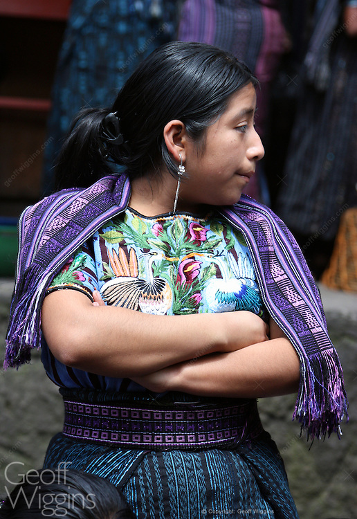 Local woman villager in traditional dress in the market of San Marcos, Lake Atitlan, Guatemala, Central America