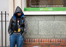 © licensed to London News Pictures. London, UK 15/02/2012. An unemployed young man outside a Jobcentre Plus in Marylebone, London, as the number of young people without a job rose 22,000 to 1.04m, official figures have shown. Photo credit: Tolga Akmen/LNP