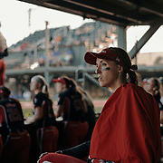 Pitcher, Monica Abbott, watches the game from the dugout with her team. The Scrap Yard Dawgs won the game 1-0.<br /> <br /> Todd Spoth for The New York Times.