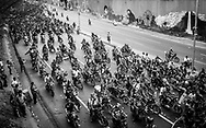 "Hundreds of motorbikes chase the official motorcade with Venezuela's President, Hugo Chávez, on a high-way of  Caracas on the 15th March, 2013. The coffin of Venezuela's President, Hugo Chávez, was translated from the Military Academy to the 4th February Military headquarters where it will stay until a final decision is made for the final place of his remains. Chávez ruled Venezuela for 14 years, passed away on the 5th March 2013.  He revolutionized not only his nation but also other countries in Latin America, with his political views and what he called the ""21st Century Socialism"", supported by the petrodollars from Venezuela's massive oil-reserves."