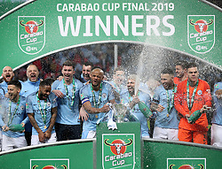 Manchester City's Vincent Kompany (centre) and his team-mates lift the trophy after during the Carabao Cup Final at Wembley Stadium, London.