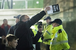 "© Licensed to London News Pictures . 03/11/2017 . Manchester , UK . A man with a copy of Robinson's book gestures towards a counter protest organised by Unite Against Fascism . Fans of Tommy Robinson (real name Stephen Yaxley-Lennon ) and anti-fascist counter demonstrators at the launch of the former EDL leader's book "" Mohammed's Koran "" at Castlefield Bowl . Originally planned as a ticket-only event at Bowlers Exhibition Centre , the launch was moved at short notice to a public location in the city . Photo credit : Joel Goodman/LNP"