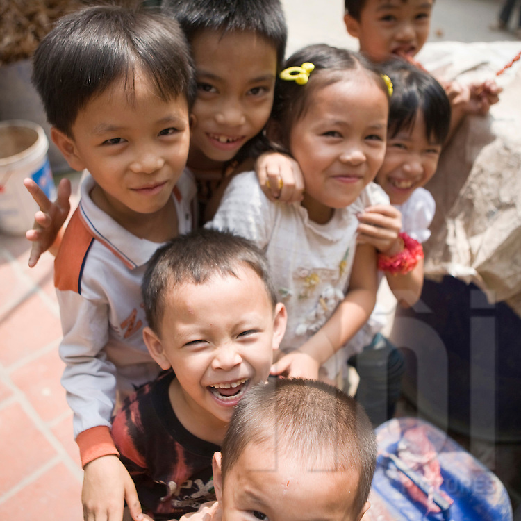 Cham Khe village is specialised in the production of paper.Kids after school having fun in front of the camera