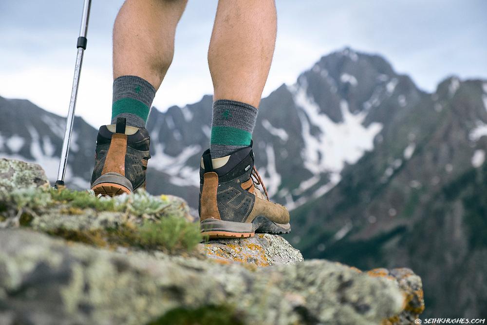 A hiker overlooks Mount Sneffels in the San Juan mountains near Ridgeway, CO.