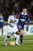 FOOTBALL - FRENCH LEAGUE CUP 2011/2012 - 1/2 FINAL - FC LORIENT v OLYMPIQUE LYONNAIS - 31/01/2012 - PHOTO PASCAL ALLEE / DPPI - LADISLAS DOUNIAMA (FCL) / MAXIME GONALONS (OL)