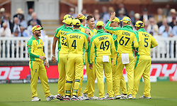 Australia's Pat Cummins celebrates catching out England's Jonny Bairstow with team mates during the ICC Cricket World Cup group stage match at Lord's, London.