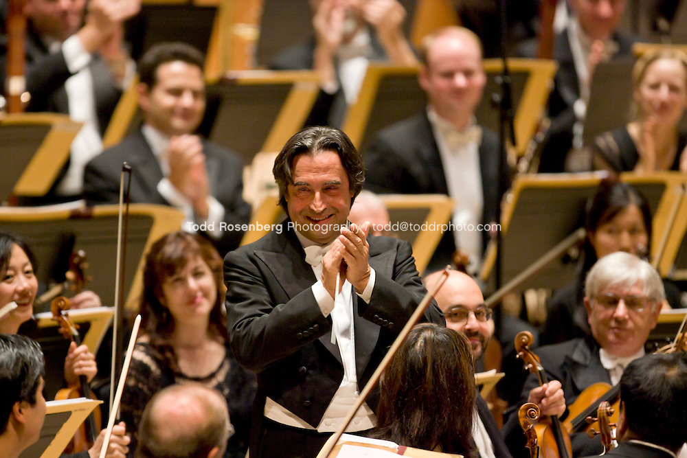 10/5/07 10:43:58 PM  Maestro Riccardo Muti applauds the Chicago Symphony Orchestra after their concert in London England.  © copyright Todd Rosenberg Photography 2007