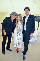 Left to right, singer BRIAN JOHNSON, GEORGIE THOMPSON and RICHARD BLAKE at a luncheon hosted by Cartier for their sponsorship of the Style et Luxe part of the Goodwood Festival of Speed at Goodwood House, West Sussex on 1st July 2012.