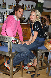 FRED URIBE and TAMSIN LONSDALE at the launch of Friday Nights at Mamilanji - Chelsea's newest and most exclusive members club, 107 Kings Road, London SW3 hosted by Charlie Gilkes and Duncan Stirling held on 29th July 2005.<br />