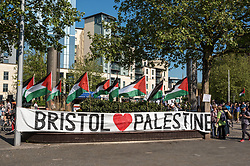 © Licensed to London News Pictures. 15/05/2018. Bristol, UK. Protest and march in solidarity with Palestine after 70 Years since the Nakba (Catastrophe) and with the Great March of Return in Palestine, calling for justice, equality and the implementation of the right of return of Palestinians to their homes in what is now Israel. Protests are being held in other cities following 58 Palestinian protesters having been killed and 2,000+ injured yesterday by Israeli forces firing on the 35,000-strong protests at the Gaza border, the most lethal in a string of such episodes as Palestinians have protested for the right to return to occupied lands over the past 6 weeks. The Bristol protest was organised by Bristol Palestine Solidarity Campaign and Bristol Stop the War Coalition with other groups. The campaign says that Between 1947 and 1949, Zionist paramilitary forces ethnically cleansed and eradicated over 500 villages and cities in Palestine, displacing 750,000 Palestinians and taking over 78% of the land. Palestinians call this process the 'Nakba', or catastrophe. Today, over 7 million Palestinian refugees are scattered around the world, many of whom live in refugee camps in the West Bank, Gaza, Lebanon, Jordan, and Syria. Photo credit: Simon Chapman/LNP
