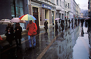 People fill the streets on a rainy day in Sarajevo, Bosnia and Herzegovina. (Supporting image from the project Hungry Planet: What the World Eats.)