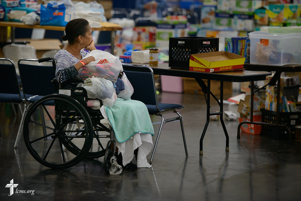 An evacuee from floodwaters after Hurricane Harvey waits at the George R. Brown Convention Center on Monday, Sept. 4, 2017, in downtown Houston. LCMS Communications/Erik M. Lunsford