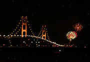 Fireworks light up the sky on the St. Ignace (north) end of the Mackinaw Bridge as part of the bridges 50th anniversary celebrations.