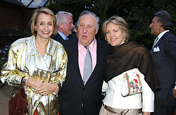Left to right, FREDERICK & SANDY FORSYTH and CARLA BAMBERGERat the annual Cartier Flower Show Diner held at The Physics Garden, Chelsea, London on 23rd May 2005.<br />