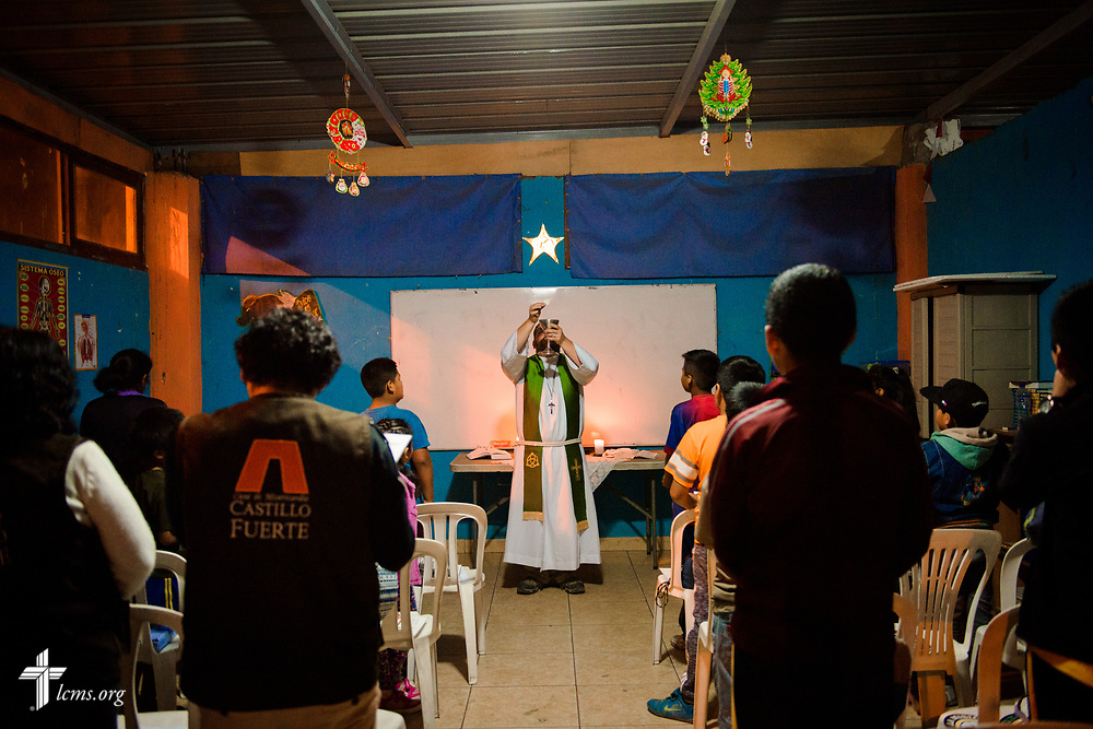 The Rev. Eddie Hosch, LCMS career missionary to Peru, consecrates the elements during worship at the Castillo Fuerte site in San Juan de Lurigancho on Tuesday Nov. 7 2017, in Peru.  LCMS Communications/Erik M. Lunsford