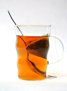 Glass cup of tea. The Tea bag can be seen in the cup