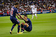 PSG Neymar helps teammate Angel Di Maria during the French championship L1 football match between Paris Saint-Germain (PSG) and Caen on August 12th, 2018 at Parc des Princes, Paris, France - Photo Geoffroy Van der Hasselt / ProSportsImages / DPPI